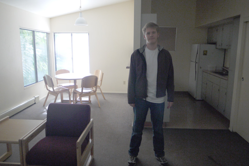 The large common area and kitchen in the on-campus apartment.