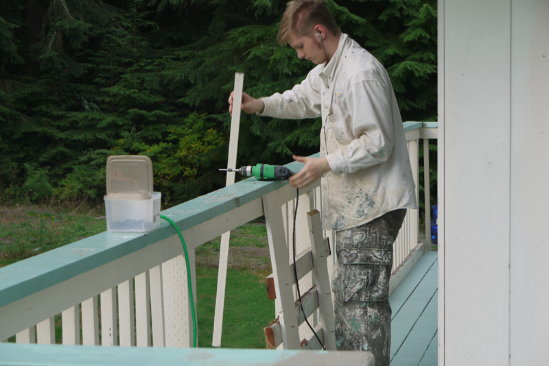 Chris installing the slats on the railings, first from above.