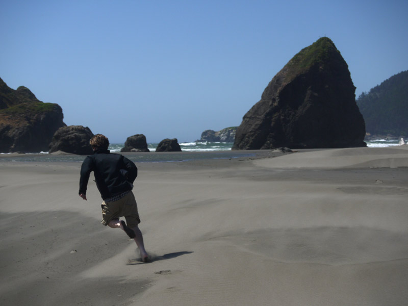 Nick running in sand, into the stiff wind.