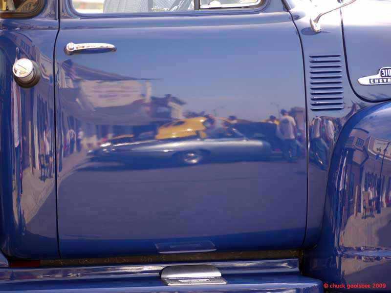 46. Reflections at a Car Show.