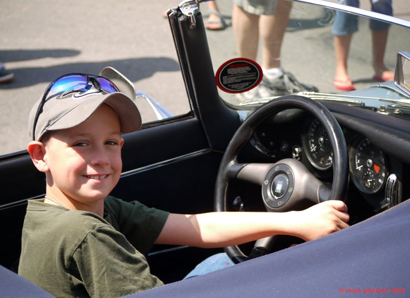 38. Smiling Kid in E-type Jaguar.