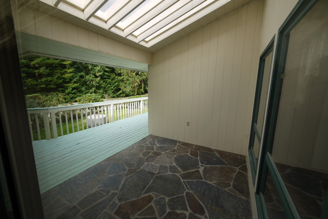 The atrium and deck between the main part of the house and the master bedroom.