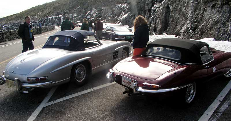 a 300sl next to an E-type Jaguar. Note the size difference.