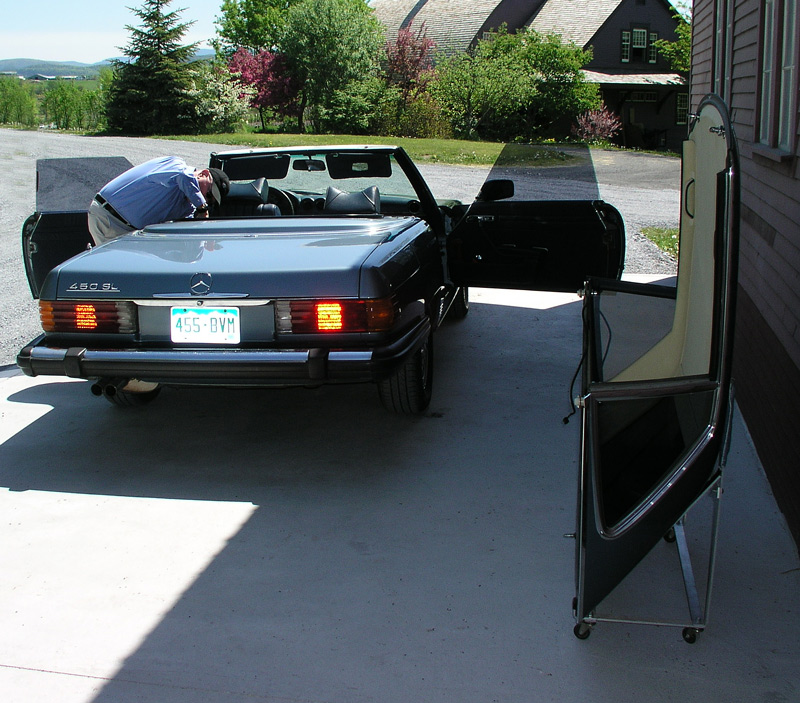 Hard top comes with its own wheeled rack for storage.