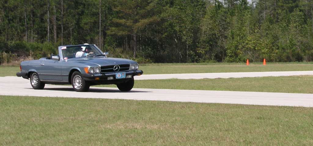 Wait a minute, what's that Beach Benz doing on a racetrack?!
