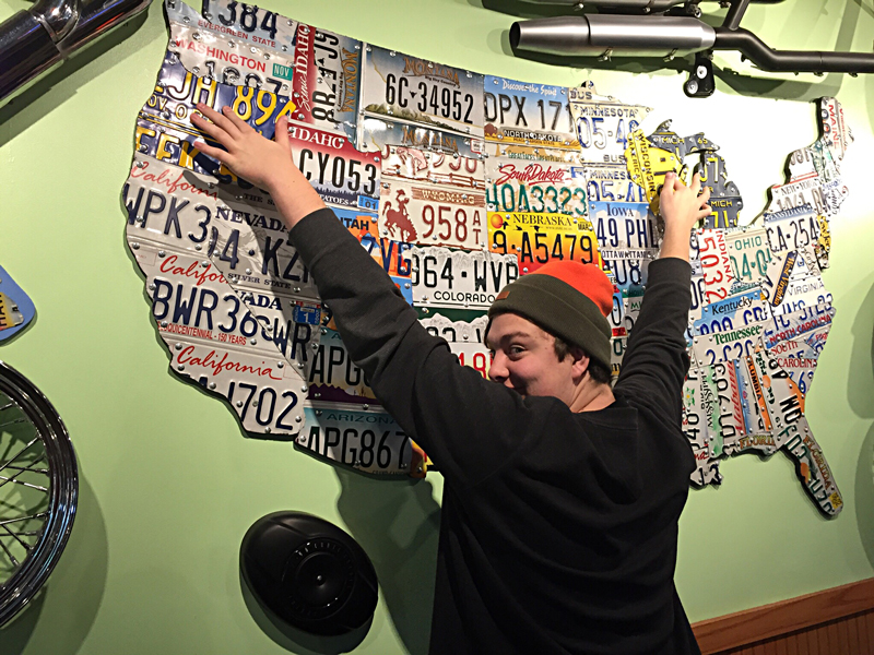Stewart shows us the end points of our journey on a map made of license plates