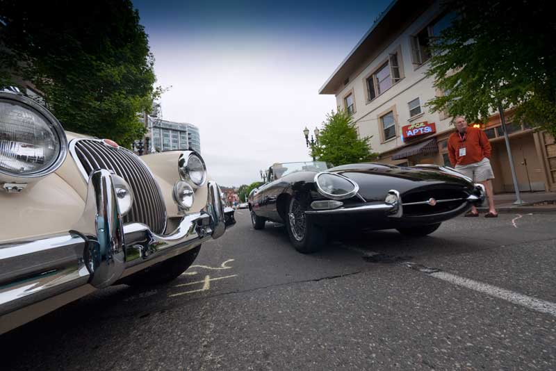 An E-type passes an XK 150.