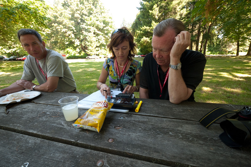 Rally Chairman Reid Trummel tries to learn some navigation skills from Yulia Smolyansky at lunch.