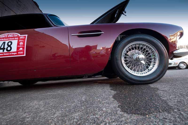An Aston-Martin DB4 marks its territory.