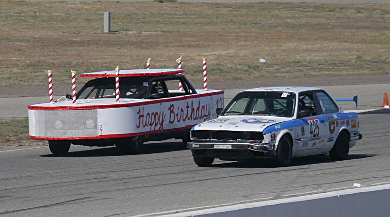 Callahan Warlick pilots the clowncar to the start-finish line past the Birthday Cake.