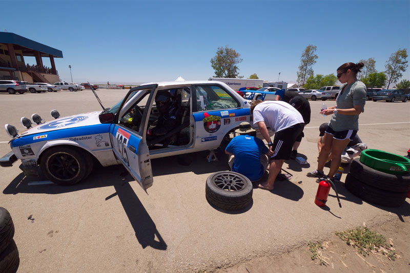 The Clowncar gets the rear brakes attended to while Elliot waits to drive the next shift. L—R: Elliot Sims, Donald Webster, Callahan Warlick, Chris Bray, Matt Kulka, and Tammie Alexander.