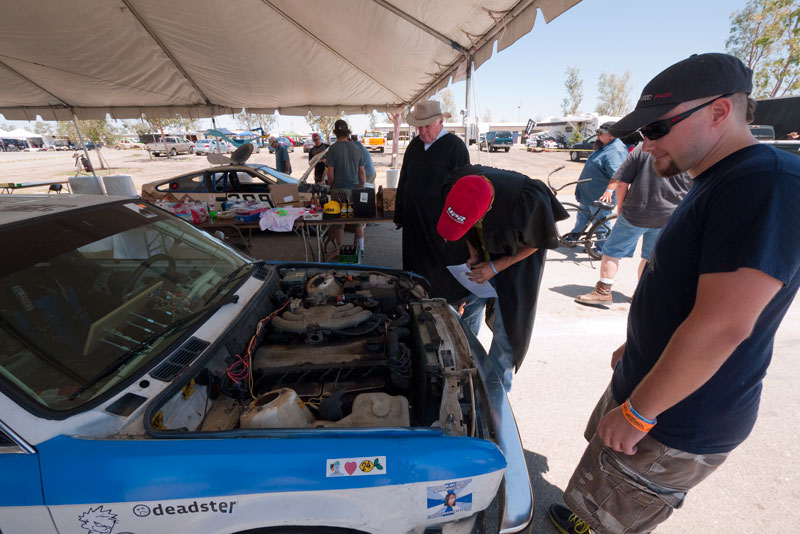 Going through tech & BS inspection - our Head Clown Matt Kulka watches the Judges look for cheats on our stock beater E30.