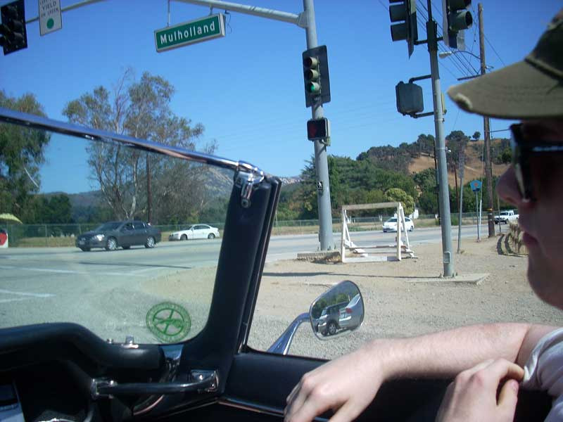 Chris and I wait for a light on Mulholland Drive as we enter LA.