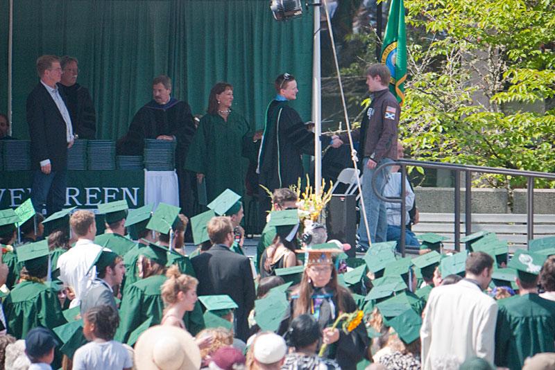 Chris receives his diploma...
