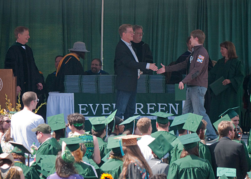Chris shaking Rick Steves' hand after receiving his diploma.