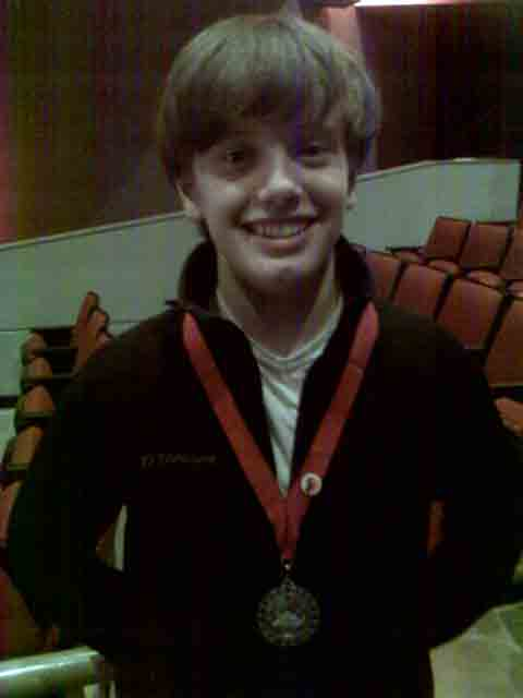 Nicholas wearing his Second Place medal