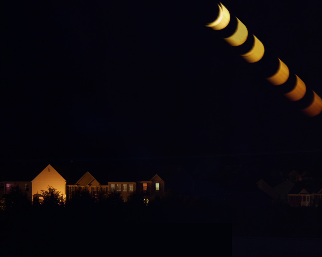 Moonset over Ashburn, VA. 10-10-10. Shot from my hotel window, Panasonic Lumix G1 45-200mm lens @ 128mm, 6 - 60 second exposures @ f/14 ISO100, blended in Photoshop using HDR processing. Aberrant first moon due again to monopod wobble.