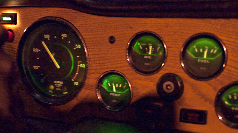 The dash of the TR-6 at night.