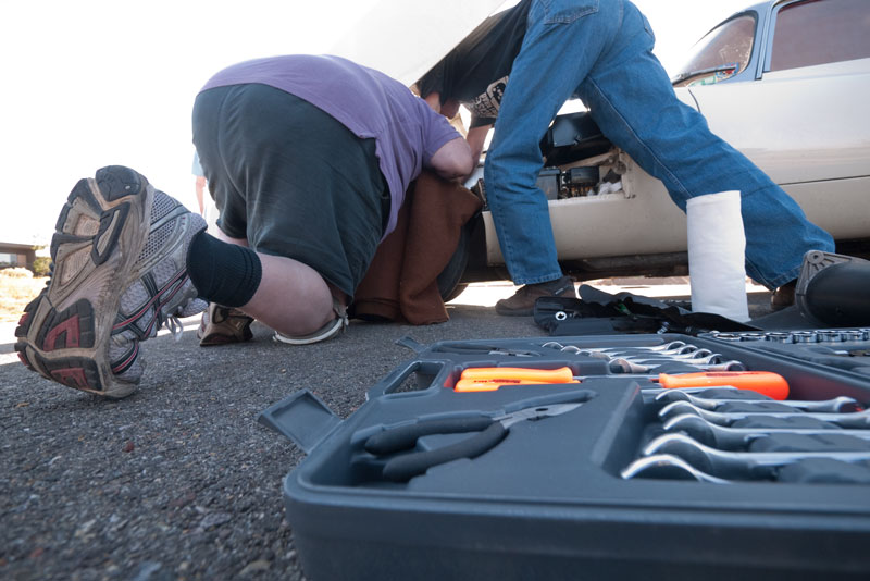 How many moron mechanics does it take to remove a generator from an E-type?