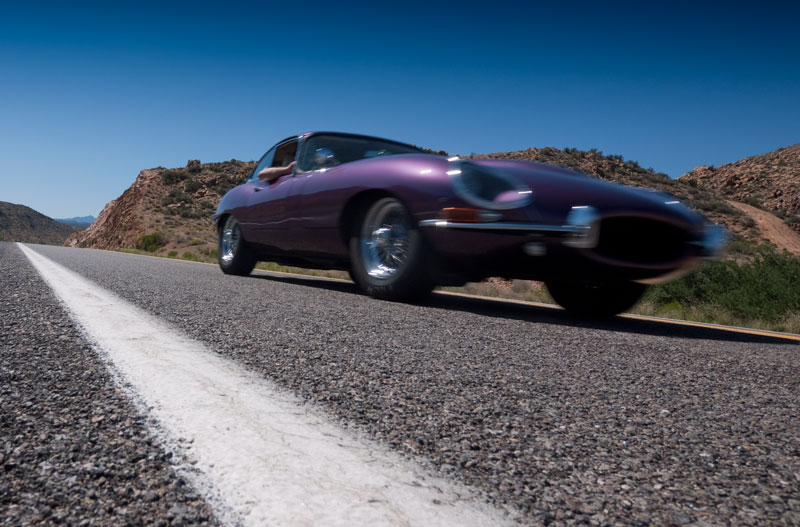 Tweety The Poiple E-type zooms along Route 66
