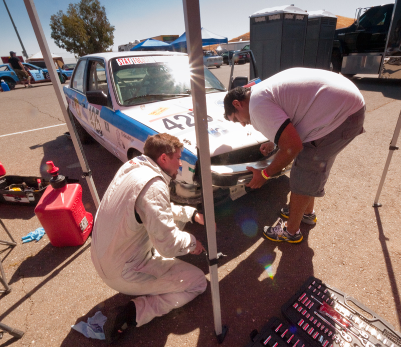 Matt Kulka and Annand Sharma try to fix the bumper.